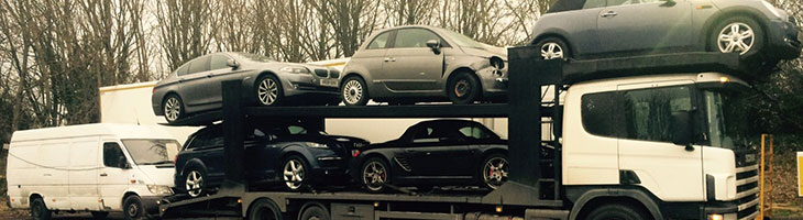 A buyer collecting several insurance write-off cars they have purchased