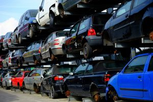 Scrap cars stacked in junkyard
