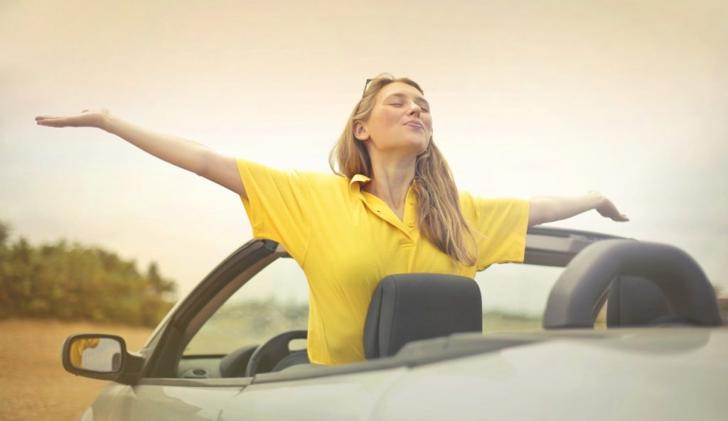 Woman enjoying music in the car