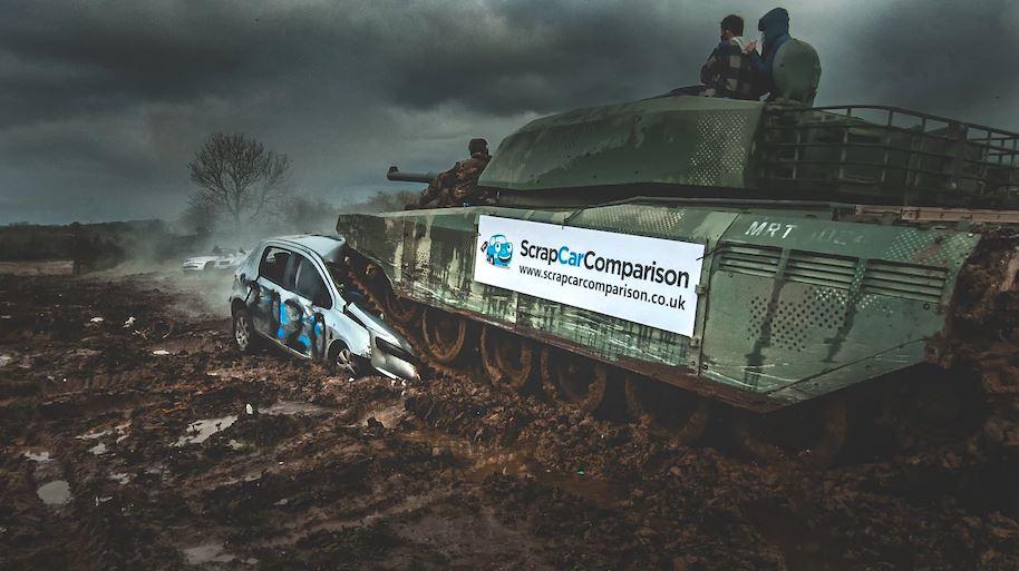 Tank crushing a scrap car